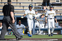 Michigan Wolverines outfielder Christian Bullock (5) and head coach Erik Bakich (23) question the umpire during the NCAA baseball game against the Michigan State Spartans on March 22, 2021 at Ray Fisher Stadium in Ann Arbor, Michigan. Michigan State beat the Wolverines 3-0. (Andrew Woolley/Four Seam Images)