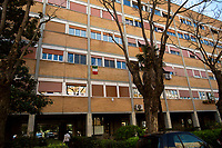 Everything will be fine.<br /> <br /> Rome, 18/03/20. Rome's Olympic Village district under the Italian Government lockdown for the Outbreak of the Coronavirus SARS-CoV-2 - COVID-19. On 22 March, the Italian PM Giuseppe Conte signed a new Decree Law which suspends non-essential industry productions and contains the list of allowed working activities, which includes Pharmaceutical & food Industry, oil & gas extraction, clothes & fabric, tobacco, transports, postal & banking services (timetables & number of agencies reduced), delivery, security, hotels, communication & info services, architecture & engineer, IT manufacturers & shops, call centers, domestic personnel (1.).<br /> Updates: Italy: 22.03.20, 6:00PM: 46.638 positive cases; 7.024 recovered; 5.476 died.<br /> <br /> The Rome's Olympic Village (1957-1960) was designed by: V. Cafiero, A. Libera, A. Luccichenti, V. Monaco, L. Moretti. «Built to host the approximately 8,000 athletes involved in the 1960 Olympic Games, Rome's Olympic Village is a residential complex located between Via Flaminia, the slopes of Villa Glori and Monti Parioli. It was converted into public housing [6500 inhabitants, ndr] at the end of the sporting event. The intervention is an example of organic settlement, characterized by a strong formal homogeneity, consistent with the Modern Movement's principles of urbanism. The different architectural structures are made uniform by the use of some common elements: the pilotis, ribbon windows, concrete stringcourses, and yellow brick curtain covering. At the center of the neighborhood, the Corso Francia viaduct - a road bridge about one kilometer long - was built by P.L. Nervi[…]» (2.).<br /> <br /> Info COVID-19 in Italy: http://bit.do/fzRVu (ITA) - http://bit.do/fzRV5 (ENG)<br /> 1. March 22nd Decree Law http://bit.do/fFwJn (ITA)<br /> 2. (Atlantearchitetture.beniculturali.it MiBACT, ITA - ENG) http://bit.do/fFw3H<br /> 12.03.20 Rome's Lockdown for the Outbreak of the Coronavirus SARS-CoV-2 - CO
