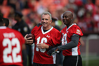 SAN FRANCISCO, CA - JULY 12:  Former San Francisco 49ers greats Joe Montana and Jerry Rice warm up on the field before the Legends of Candlestick flag football game at Candlestick Park in San Francisco, California on July 12, 2014. Photo by Brad Mangin
