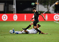 LAKE BUENA VISTA, FL - JULY 18: Rolf Feltscher #25 of LA Galaxy slide tackles the ball away from Diego Rossi #9 of LAFC during a game between Los Angeles Galaxy and Los Angeles FC at ESPN Wide World of Sports on July 18, 2020 in Lake Buena Vista, Florida.