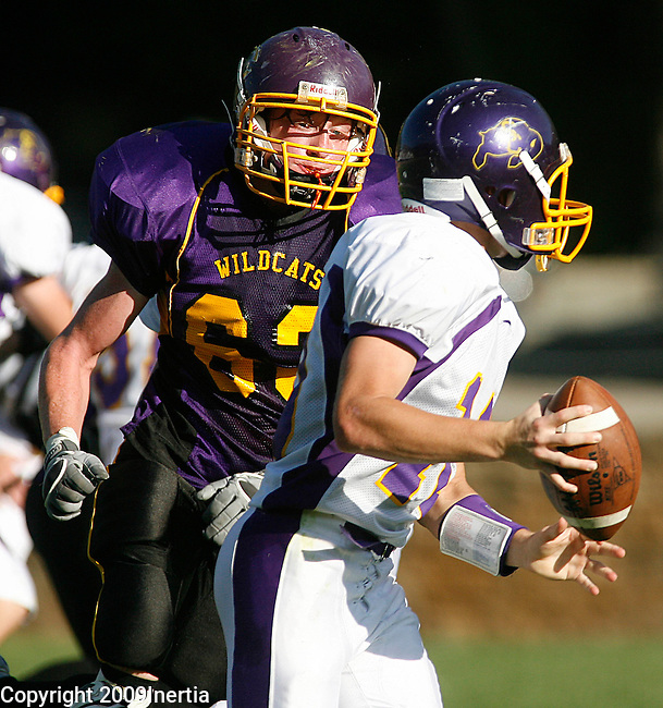 DEADWOOD, SD -- SEPTEMBER 19, 2009 -- Tony Crackel #63 of Custer closes in on Stanley County quarterback Josh Rogers during their game at the Prospector Bowl at Ferguson Field in Deadwood Saturday. (Photo by Dick Carlson/Inertia)
