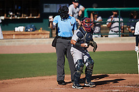 Home plate umpire Jacob McConnell makes a strike call as catcher Victor De Hoyos (46) checks the runner on first base during the game against the Charleston RiverDogs at Joseph P. Riley, Jr. Park on June 27, 2021 in Charleston, South Carolina. (Brian Westerholt/Four Seam Images)