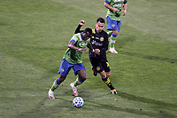 COLUMBUS, OH - DECEMBER 12: Nouhou Tolo #5 of the Seattle Sounders FC challenges Lucas Zelarayan #10 of the Columbus Crew for the ball during a game between Seattle Sounders FC and Columbus Crew at MAPFRE Stadium on December 12, 2020 in Columbus, Ohio.
