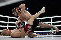 Moscow, Russia, 05/06/2010..Zubaira Tukhugov punches Danil Turinge in the face during a mix-fight bout at Fight Nights, a new Moscow boxing tournament..