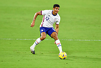 ORLANDO CITY, FL - JANUARY 31: Miles Robinson #12 of the United States turns with the ball during a game between Trinidad and Tobago and USMNT at Exploria stadium on January 31, 2021 in Orlando City, Florida.