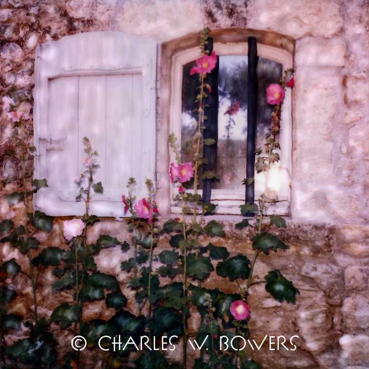 Oppede hollyhocks brighten the view from inside and outside the home. After being abandoned in the 17th Oppede has gained new life.<br /> <br /> -Limited Edition of 50 Prints