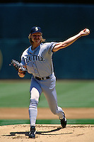 OAKLAND, CA - Randy Johnson of the Seattle Mariners pitches during a game against the Oakland Athletics at the Oakland Coliseum in Oakland, California in 1997. (Photo by Brad Mangin)