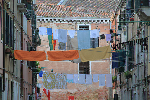 Italy, Venice.  Laundry Art. <br /> Remember the artist Christo, probably not? <br /> Venice side street, Italy.