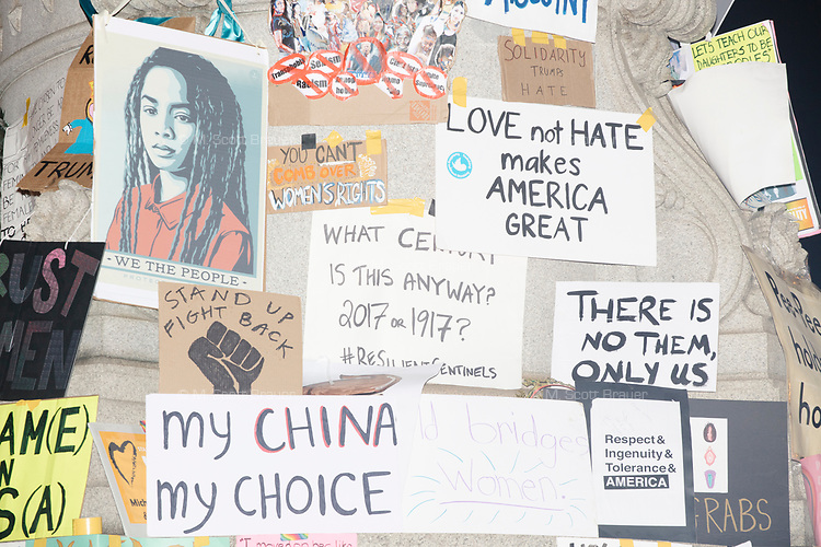 After the protest, people displayed protest signs they brought to the 2017 Women's March on Washington next to a statue in Thomas Circle Park on Jan. 21, 2017, in Washington D.C.