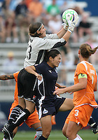 Homare Sawa#10 of the Washington Freedom loses the ball to Jenni Branam#23 of Sky Blue FC during a WPS match at Maryland Soccerplex on August 8,2009 in Boyds, Maryland.