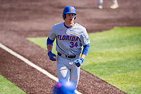 Florida Gators pinch hitter Kris Armstrong (34) jogs to the plate following a game-winning home run against the Tennessee Volunteers on Robert M. Lindsay Field at Lindsey Nelson Stadium on April 11, 2021, in Knoxville, Tennessee. (Danny Parker/Four Seam Images)