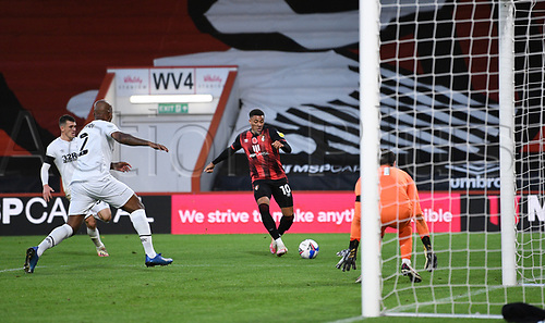31st October 2020; Vitality Stadium, Bournemouth, Dorset, England; English Football League Championship Football, Bournemouth Athletic versus Derby County; Arnaut Danjuma of Bournemouth prepares to shoot under pressure from Andre Wisdom of Derby County