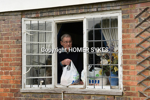 The Biddenden Charity Dole. Kent UK 2008. Easter Monday.  56 local OAP collect bread, cheese and tea from the window of the Old Workhouse Cottage.