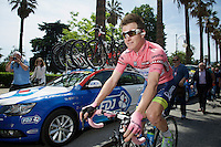 overall race leader/pink jersey Simon Clarke (AUS/Orica-GreenEDGE) on his way to the start with a smile on his face<br /> <br /> 2015 Giro<br /> stage 5: La Spezia - Abetone (152km)