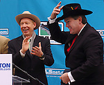 AEG President and CEO Timothy Leiweke tries on a hat given to him by Houston Mayor Bill White,at left, during a news conference welcoming Major League Soccer to Houston outside Houston City Hall Friday Dec. 16,2005.