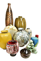 BNPS.co.uk (01202 558833)<br /> Pic: AdamPartridgeAuctioneers/BNPS<br /> <br /> Pictured: The variety of pots were stunning<br /> <br /> A huge collection of pottery and ceramics found stacked inside the suburban home of an elderly couple has sold for almost £200,000.<br /> <br /> Leonard and Alison Shurz filled every room of their three bed house with ceramic pieces they had gathered from all over the world.<br /> <br /> The Aladdin's Cave of pots, bowls, plates, vases and jugs was found by a stunned auctioneer who had the daunting task of cataloguing it all.