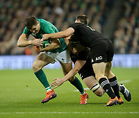 Saturday 17th November 2018 | Ireland vs New Zealand<br /> <br /> Jacob Stockdale his tackled by Brodie Retallick and Ben Smith during 2018 Guinness Series between Ireland and Argentina at the Aviva Stadium, Lansdowne Road, Dublin, Ireland. Photo by John Dickson / DICKSONDIGITAL
