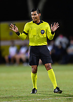 LAKE BUENA VISTA, FL - JULY 26: Referee Victor Rivas attempts to calm players during a game between Vancouver Whitecaps and Sporting Kansas City at ESPN Wide World of Sports on July 26, 2020 in Lake Buena Vista, Florida.