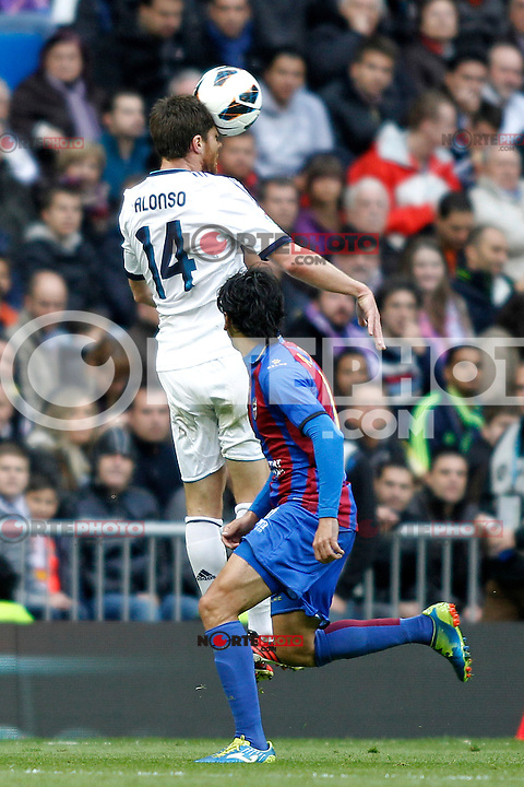 Real Madrid's Xabi Alonso and Levante's Pedro Rios during La Liga BBVA match. April 6, 2013.(ALTERPHOTOS/Alconada)