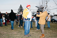 A Boston Herald reporter interviews Cruz supporter Gary Gahan, of Merrimack, New Hampshire, before Texas senator and Republican presidential candidate Ted Cruz speaks at a Second Amendment Rally outside Granite State Indoor Range in Hudson, New Hampshire.