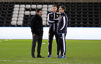 Watford manager Quinque Sanchez Flores (L) with colleagues on the pitch before the Barclays Premier League match between Swansea City and Watford at the Liberty Stadium, Swansea on January 18 2016