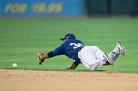 New Orleans Zephyrs second baseman Joe Thurston #30 dives for a ground ball during a game against the Round Rock Express at the Dell Diamond on July 20, 2011 in Round Rock, Texas.  New Orleans defeated Round Rock 14-11.  (Andrew Woolley/Four Seam Images)