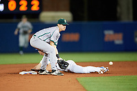 Siena Saints shortstop Marcos Campos (9) fields a throw as Wil Dalton (16) steals second base during a game against the Florida Gators on February 16, 2018 at Alfred A. McKethan Stadium in Gainesville, Florida.  Florida defeated Siena 7-1.  (Mike Janes/Four Seam Images)