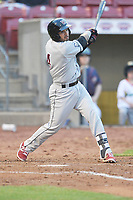 Wisconsin Timber Ratters catcher Mario Feliciano (4) swings during a game against the Cedar Rapids Kernels at Veterans Memorial Stadium on April 13, 2017 in Cedar Rapids, Iowa.  The Kernels won 2-1.  (Dennis Hubbard/Four Seam Images)