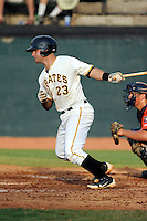Catcher Daniel Arribas (23) of the Bristol Pirates bats in a game against the Greeneville Astros on Saturday, July 26, 2014, at DeVault Memorial Stadium in Bristol, Virginia. Greeneville won, 2-1 in Game 1 of a doubleheader. (Tom Priddy/Four Seam Images)
