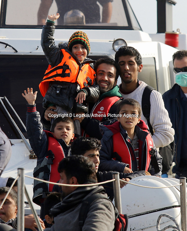 Pictured: Young boys are cheering on as the Coastguard vessel carrying them to safety approaches Ierapetra Thursday 27 November 2014<br /> Re: One of the largest refugee boats in recent months has disembarked refugees in Ierapetra, Crete. The freighter Baris, carrying 700 people thought to be from Syria and Afghanistan, is being towed by a Greek frigate.<br /> Officials and Red Cross volunteers prepared an indoor basketball stadium as interim shelter in the southern Cretan port town of Ierapetra on Wednesday ahead of the migrants' expected arrival.<br /> Greek officials said the Baris, which lost propulsion on Tuesday, was being towed slowly in poor sea conditions and would arrive after nightfall, probably early Thursday.<br /> They said it was unclear which Mediterranean location had been the departure point for the 77-meter (254-foot) vessel, which was sailing under the flag of the Pacific nation of Kiribati.