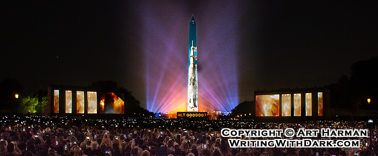 Apollo 11 50th Anniversary Celebration by Art Harman. The Saturn rocket was projected on the Washington Monument.
