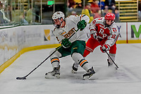 29 December 2018: University of Vermont Catamount Defenseman Carter Long, a Freshman from Yorktown, VA, keeps the puck away from Rensselaer Engineer Forward Jacob Hayhurst, a Junior from Missassauga, ON, during first period action at Gutterson Fieldhouse in Burlington, Vermont. The Catamounts rallied from a 2-0 deficit to defeat RPI 4-2 and win the annual Catamount Cup Tournament. Mandatory Credit: Ed Wolfstein Photo *** RAW (NEF) Image File Available ***