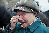 Moscow, Russia, 15/01/2011..A woman weeps during a rally at the bus stop where Spartak soccer fan Yegor Sviridov was killed in a street fight with a group of men from the southern Caucasus, leading to a nationalist backlash that has spilled into racist violence on the streets of Moscow and other Russian cities. The rally on the 40th day after Sviridov's death was attended by a mixture of local people, football fans and Russian nationalists.