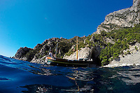 The boat driver relaxes during a tour on Monday, Sept. 21, 2015, off the island of Capri in Italy. (Photo by James Brosher)