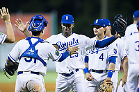 Seuly Matias (25) of the Burlington Royals celebrates with teammate Jesus Atencio (31) after their win over the Danville Braves at Burlington Athletic Stadium on August 15, 2017 in Burlington, North Carolina.  The Royals defeated the Braves 6-2.  (Brian Westerholt/Four Seam Images)