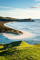 Morning on Wickliffe Bay on Otagao Peninsula. Victory Beach and Papanui Inlet in centre, Otago, East Coast, New Zealand