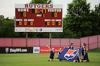 Kids hold the Sky Blue FC flag during player introductions. Sky Blue FC and the Washington Freedom played to a 4-4 tie during a Women's Professional Soccer match at Yurcak Field in Piscataway, NJ, on July 15, 2009.