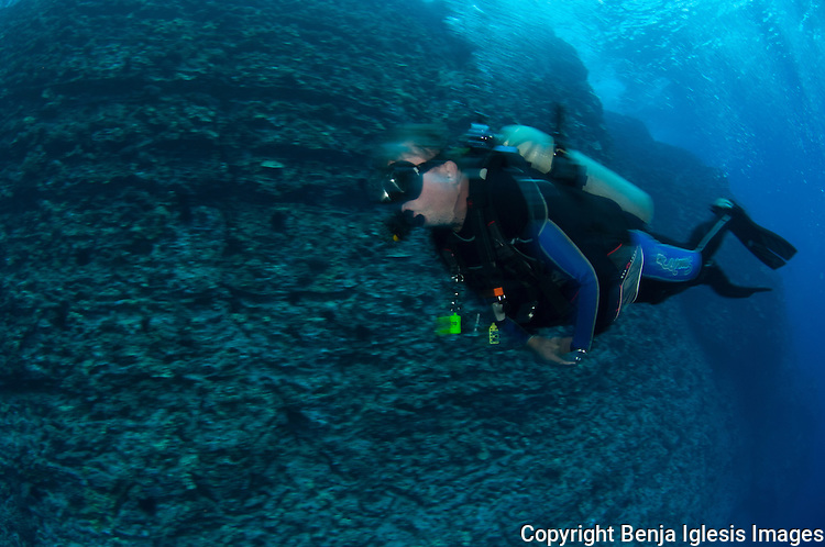 Diver on a drift dive at the backwall Molokini Maui Hawaii.Current at the back wall can be very strong is an advanced level dive.