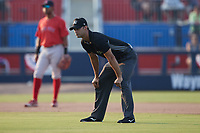Umpire Steve Craze handles the calls on the bases during the game between the Salem Red Sox and the Kannapolis Cannon Ballers at Atrium Health Ballpark on July 29, 2021 in Kannapolis, North Carolina. (Brian Westerholt/Four Seam Images)