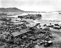 Invasion of Ichon, Korea.  Four LST's unload men and equipment on beach.  Three of the LST's shown are LST-611, LST-745, and LST-715.  September 15, 1950.  C.K. Rose. (Navy)<br /> NARA FILE #:  080-G-420027<br /> WAR & CONFLICT BOOK #:  1406