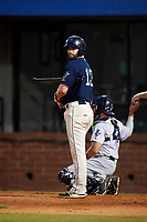 Mobile BayBears third baseman Andrew Daniel (13) at bat in front of catcher Adrian Nieto (17) during a game against the Pensacola Blue Wahoos on April 25, 2017 at Hank Aaron Stadium in Mobile, Alabama.  Mobile defeated Pensacola 3-0.  (Mike Janes/Four Seam Images)