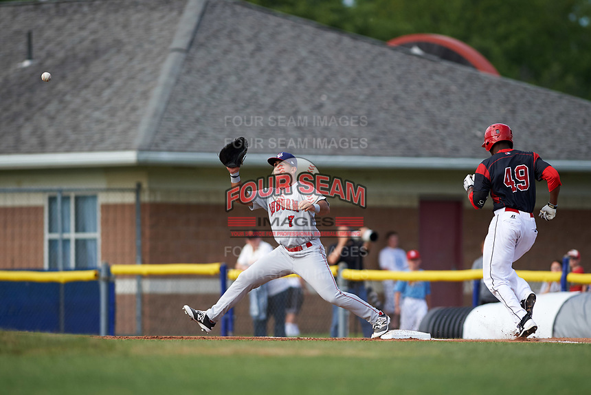 Auburn Doubledays first baseman Conner Simonetti (7) stretches for a throw to force out Thomas Jones (49) during a game against the Batavia Muckdogs on June 19, 2017 at Dwyer Stadium in Batavia, New York.  Batavia defeated Auburn 8-2 in both teams opening game of the season.  (Mike Janes/Four Seam Images)