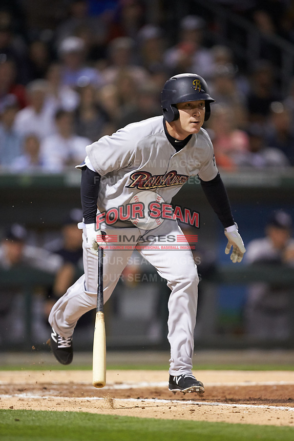 Cody Asche (12) of the Scranton/Wilkes-Barre RailRiders starts down the first base line during the game against the Charlotte Knights at BB&T BallPark on April 12, 2018 in Charlotte, North Carolina.  The RailRiders defeated the Knights 11-1.  (Brian Westerholt/Four Seam Images)