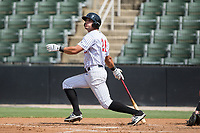 Aaron Schnurbusch (21) of the Kannapolis Intimidators follows through on his swing against the Hagerstown Suns at Kannapolis Intimidators Stadium on July 9, 2017 in Kannapolis, North Carolina.  The Intimidators defeated the Suns 3-2 in game one of a double-header.  (Brian Westerholt/Four Seam Images)