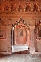 Fatehpur Sikri, Uttar Pradesh, India.   Hindu Architectural Influences in Birbal's Palace, Residence of the Emperor's Senior Wives.  Corbelled Arches, Geometric and Floral Wall Designs.