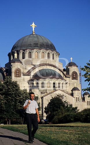 Belgrade, Serbia, Yugoslavia. Man walking in front of St Sava's Temple, on the Vracar Plateau.