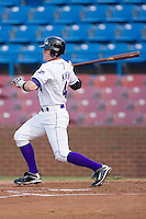 Tyler Kuhn #4 of the Winston-Salem Dash follows through on his swing versus the Frederick Keys at Wake Forest Baseball Stadium August 6, 2009 in Winston-Salem, North Carolina. (Photo by Brian Westerholt / Four Seam Images)