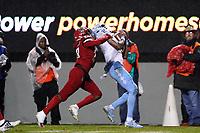 RALEIGH, NC - NOVEMBER 30: Dyami Brown #2 of the University of North Carolina catches the ball behind Kishawn Miller #28 of North Carolina State University during a game between North Carolina and North Carolina State at Carter-Finley Stadium on November 30, 2019 in Raleigh, North Carolina.