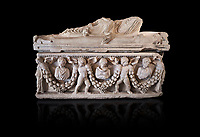 Roman relief garland  sculpted sarcophagus, style typical of Pamphylia, 3rd Century AD, Konya Archaeological Museum, Turkey. Against a black background
