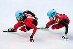 Charles Hamelin of Canada being followed by (R) Tianyu Han of China during the Short Track Speed Skating as part of the 2014 Sochi Olympic Winter Games at Iceberg Skating Palace on February 10, 2014 in Sochi, Russia. Photo by Victor Fraile / Power Sport Images